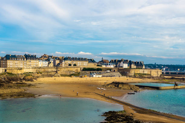 Saint Malo old town ramparts cityscape or skyline and Plage de Bon-Secours on a sunny day, Brittany, France. stock photo