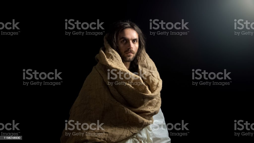 Saint man in robe looking into camera, righteous Christian life,...