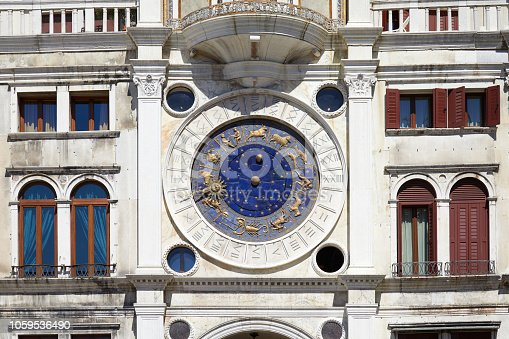 istock Saint Mark clock tower and building in Venice with gold zodiac signs in a sunny day in Italy 1059536490