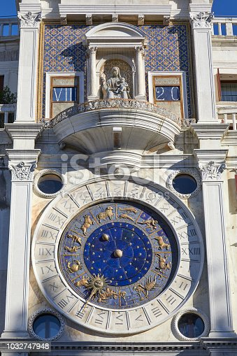 istock Saint Mark clock tower in Venice with gold zodiac signs and balcony with holy Mary statue in a sunny day in Italy 1032747948