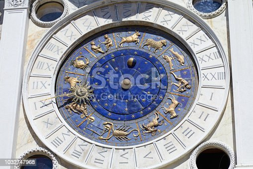 istock Saint Mark clock tower in Venice with gold zodiac signs in a sunny day in Italy 1032747968