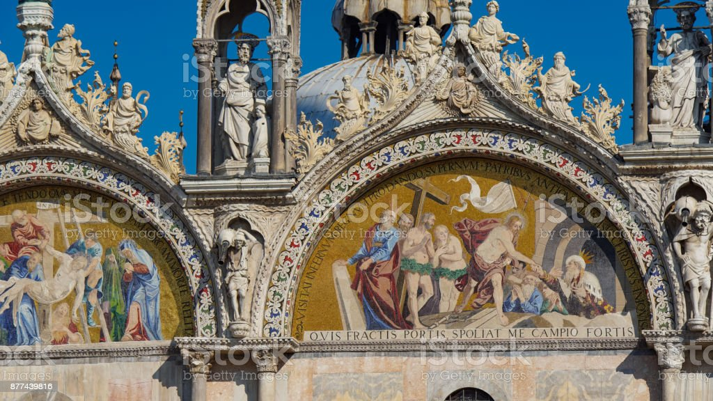 Saint Mark's Basilica in Venice, ITALY. Architectural details of Saint Mark's Basilica, Venice, Italy. Saint Mark's golden lion, symbol of the Serenissima Venice Republic stock photo