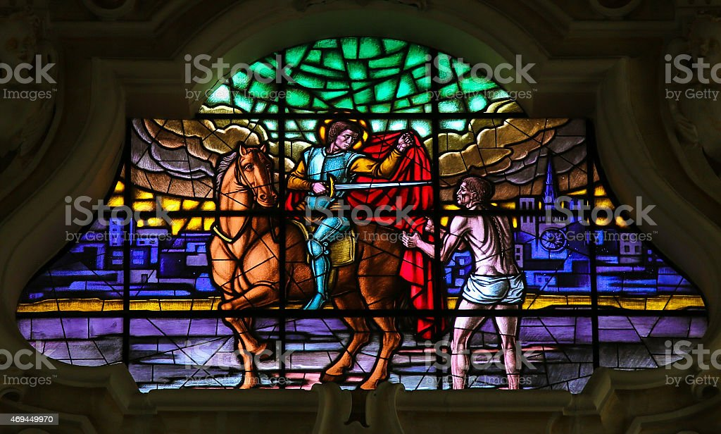 Saint Martin of Tours giving his cloak to the Beggar stock photo