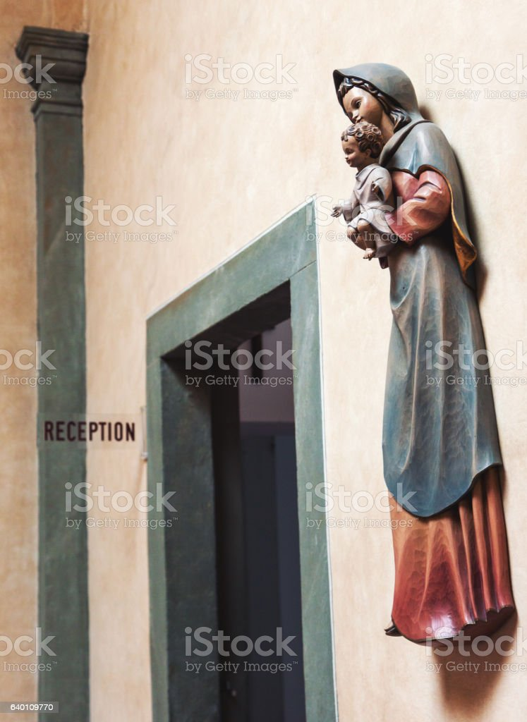Saint Mary and baby Jesus sculpture stock photo