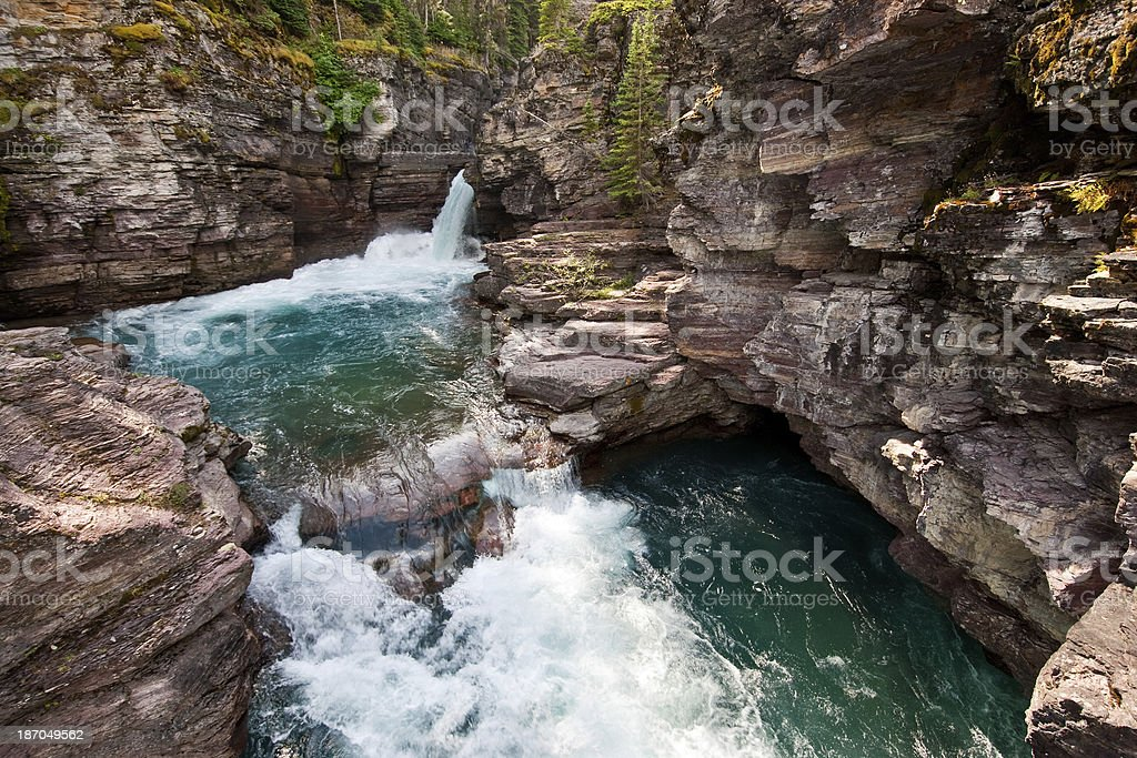 Saint Mary Falls Saint Mary Falls is one of the more spectacular falls on the Saint Mary River which flows into Saint Mary Lake. Saint Mary Falls is near the Going to the Sun Road in Glacier National Park, Montana, USA. Beauty In Nature Stock Photo