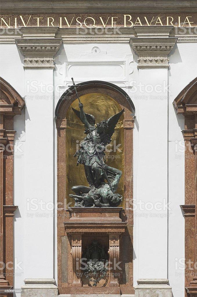 Saint Michael defeats Satan stock photo