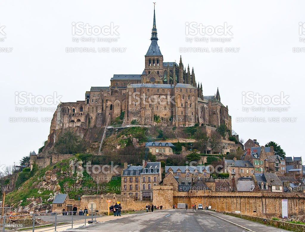 Saint Michael's Mount from the causeway in the. Normandy, France. stock photo
