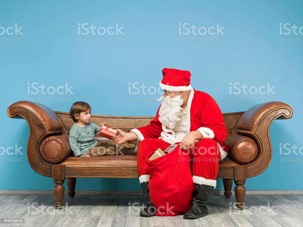 Saint Nicholas Giving Christmas Gift To Cute Little Boy stock photo ...