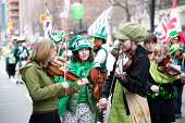 Vancouver, BC, Canada-March 16, 2008:This is a celebration for Saint Patrick\\'s Day in Vancouver downtown. The parade was consisted of musicians, bands, and other instrumental players. The colour green and the four leaf clover is a symbol for this day.