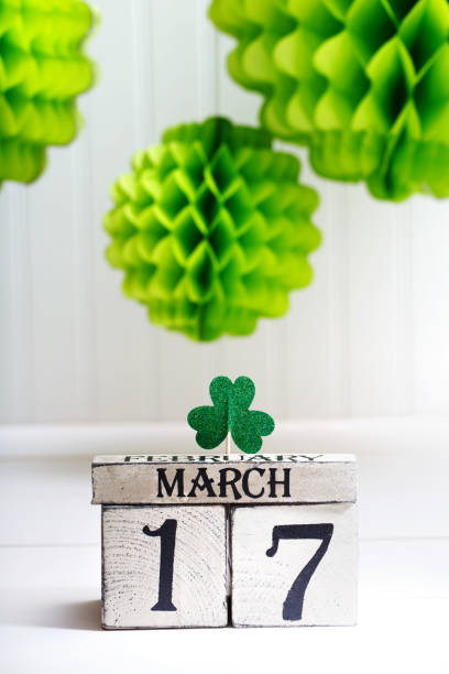 saint patricks day green clover with calendar - happy st. patricks day stock photos and pictures