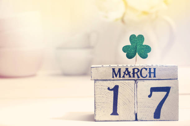 saint patricks day green clover with calendar - st patricks day stock photos and pictures