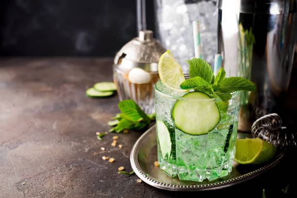 saint patrick's day green drink cocktail with lime and mint - st patricks day food stock photos and pictures