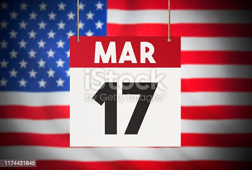 Calendar standing in front of the American flag and showing March 17 Stock Image