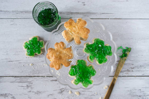 saint patrick's day shamrock biscuits with green jelly - st patricks day food stock photos and pictures