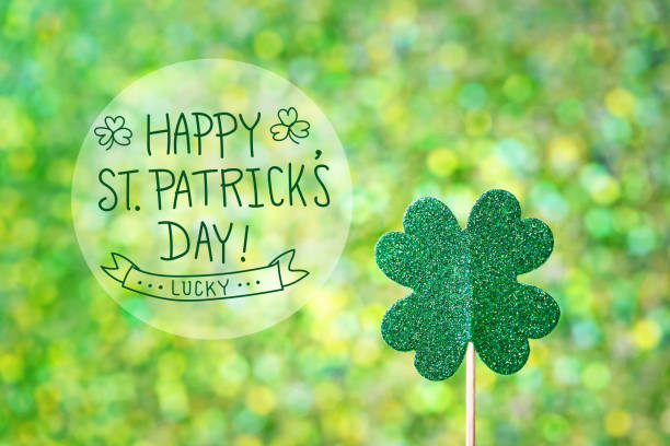 saint patricks day shiny green clover - st patricks day stock photos and pictures