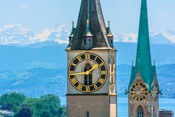 Saint Peter and Fraumünster Church Saint Peter and Fraumünster Church in Zurich (Switzerland) in front of lake Zurich and the Swiss Alps fraumunster stock pictures, royalty-free photos & images