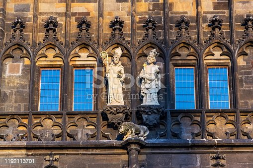 istock Saint Procopius of Sazava and Saint Sigismund of Burgundy sculptures on the Old Town Bridge Tower guarding end of the Charles Bridge in Prague, Czech Republic, sunny summer morning 1192113701