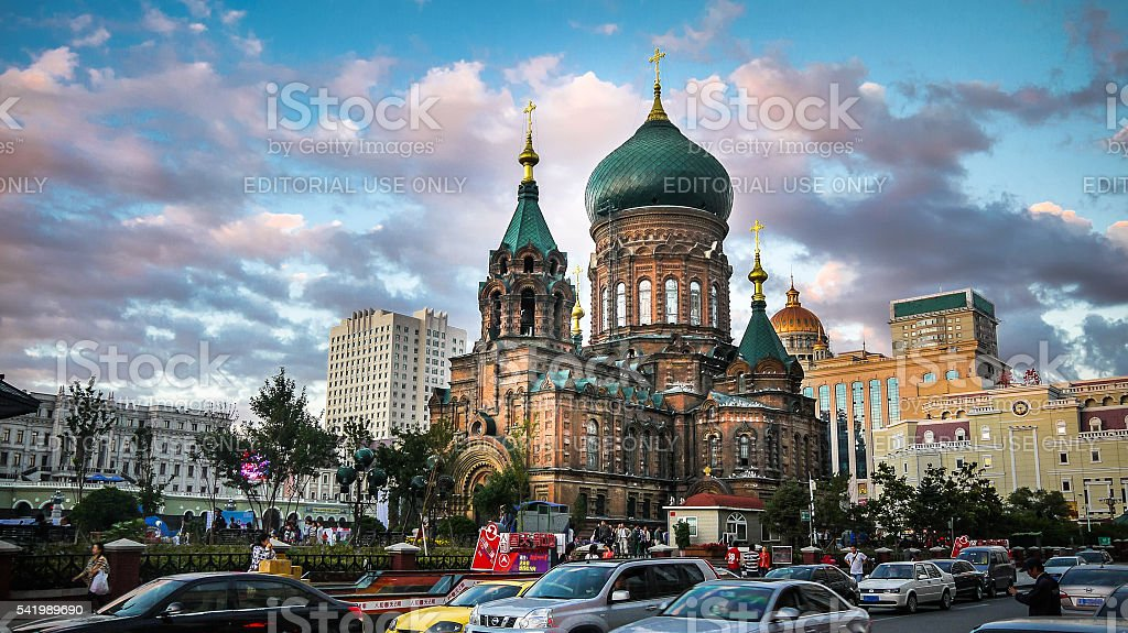 Saint Sophia Cathedral in Harbin by dusk in busy downtown stock photo