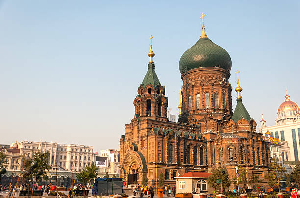 Saint Sophia Cathedral Harbin, China - October 17, 2013: Saint Sophia Cathedral and walking people at dusk. October 17, 2013 in Harbin City, Heilongjiang Province, China. harbin stock pictures, royalty-free photos & images