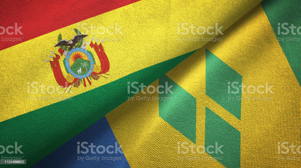 Saint Vincent and the Grenadines and Bolivia two flags together textile cloth, fabric texture stock photo