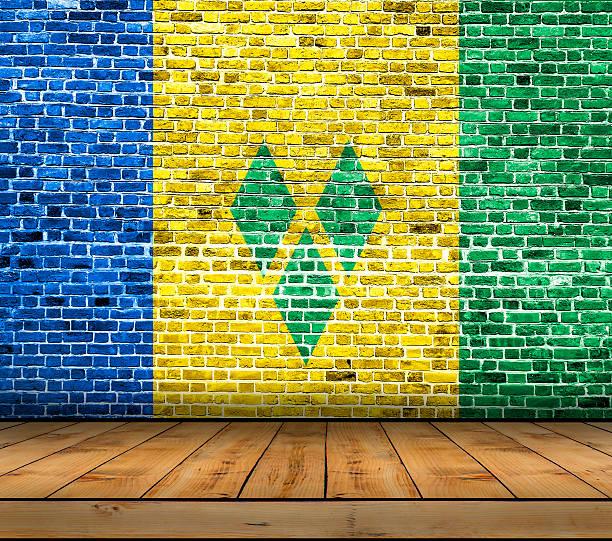 saint vincent and the grenadines flag painted on brick wall - st. vincent und die grenadinen stock-fotos und bilder
