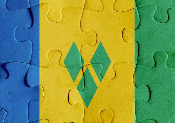 st. vincent und die grenadinen flag puzzle - kingstown stock-fotos und bilder