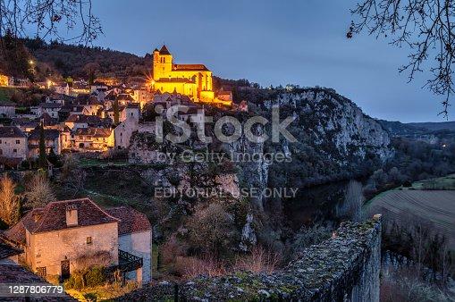 istock saint-cirq-lapopie at dusk, France 1287806779