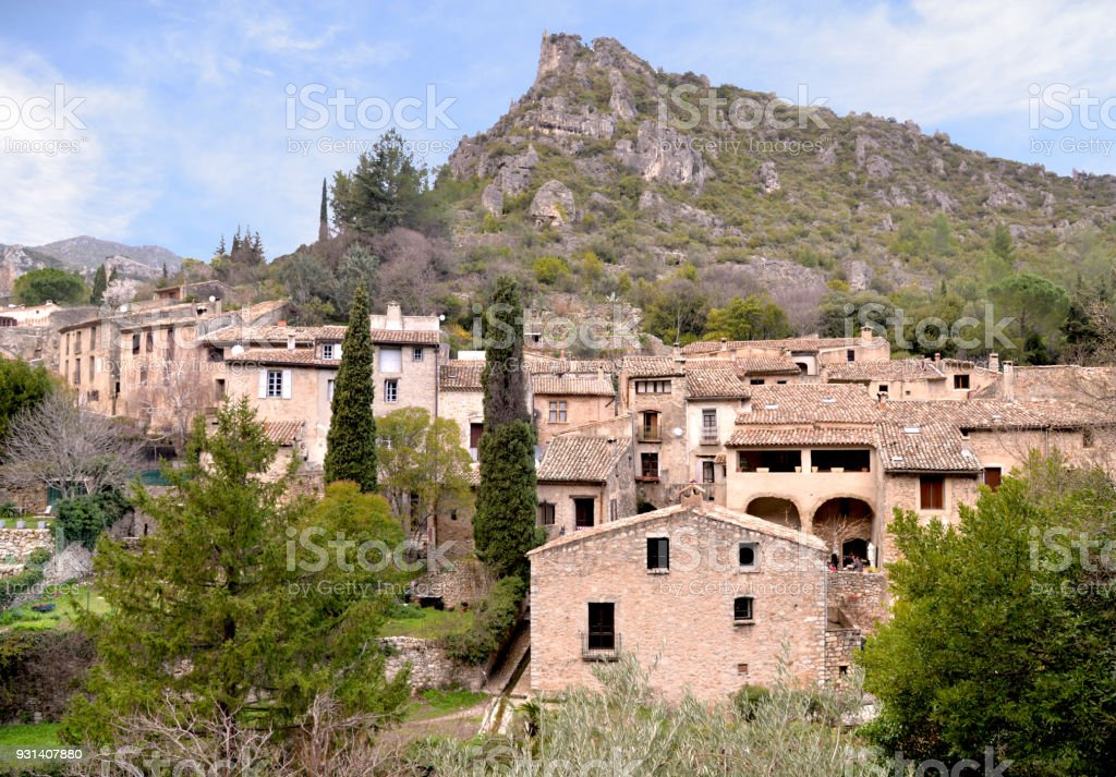 Saint-Guilhem-le-désert. French medieval village. Southern France. Near Montpellier. UNESCO world heritage site and part of the Routes of Santiago de Compostela. stock photo
