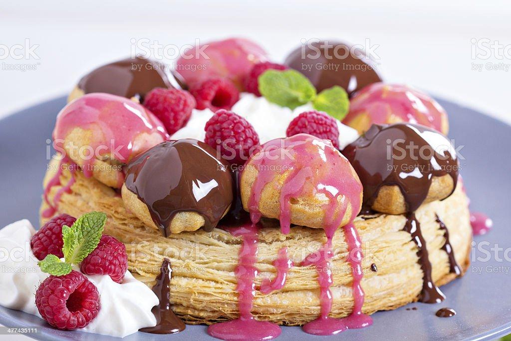 Saint-Honore cake with chocolate and raspberry stock photo
