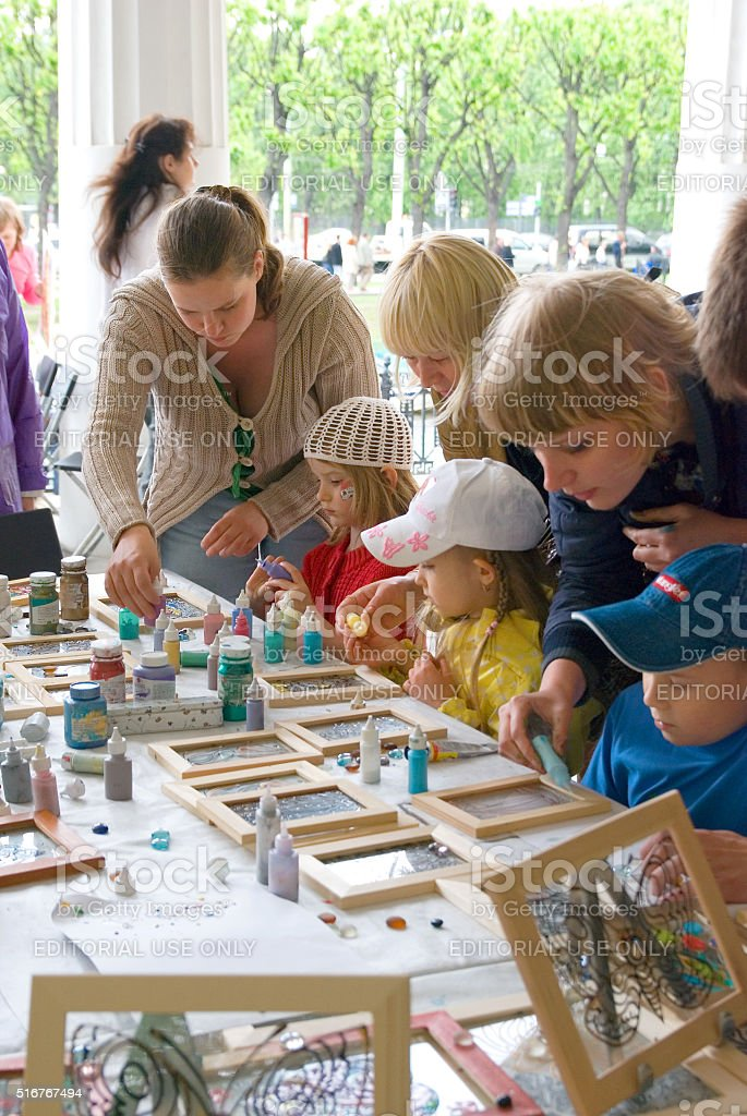 Saint-Petersburg. Russia. Children draw on the glass stock photo