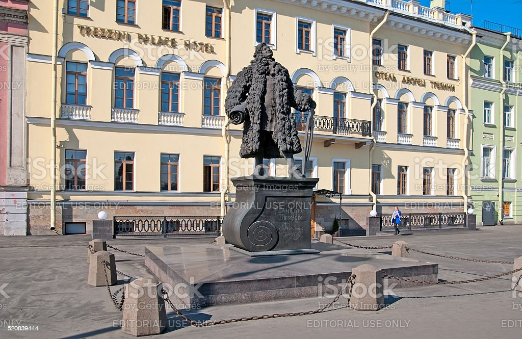 Saint-Petersburg. Russia. Woman near Domenico Trezzini Statue stock photo