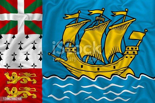Saint-Pierre and Miquelon flag on wavy silk textile fabric background.