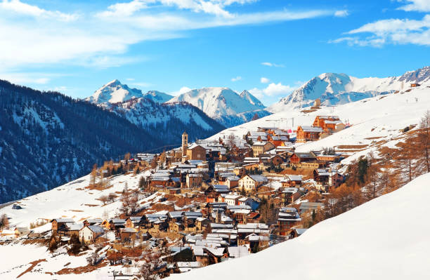 Saint-Véran in the southern French Alps. The alignments of the houses of the highest village in Europe, center of tourist interest and winter sports. ski holiday stock pictures, royalty-free photos & images