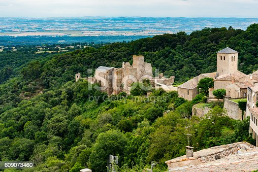 Saissac in France with church and damaged ruin