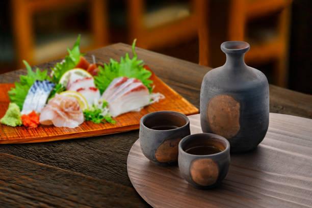 Sake and delicious sashimi stock photo