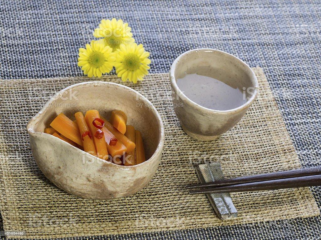 Sake and Japanese pickle stock photo