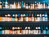 istock Sake Bottles on shelf Japanese bar Blur background 1217308373