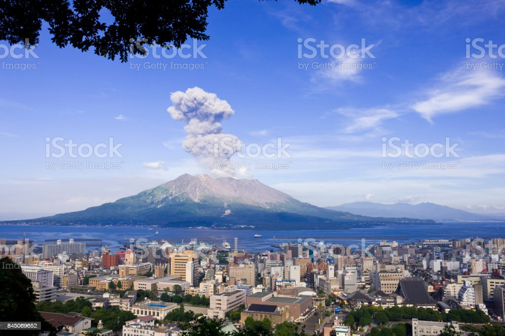 Sakura-jima plumes to raise and Kagoshima City Sakura-jima plumes to raise and Kagoshima City Active Volcano Stock Photo