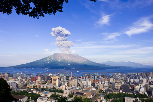 Sakurajima Plumes To Raise And Kagoshima City Stock Photo - Download Image Now
