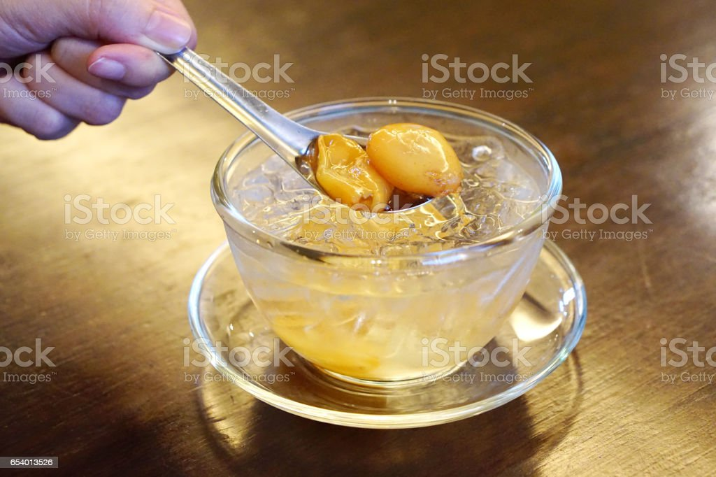 Salacca zalacca in sweet syrup and ice cube,It's famous and delicious thai style dessert, salacca is tropical fruit in Thailand. stock photo
