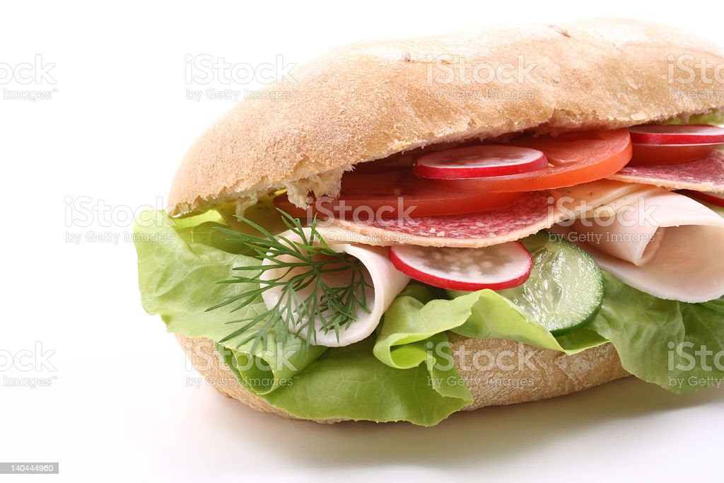 Salad and ham sandwich on white bread roll royalty-free stock photo