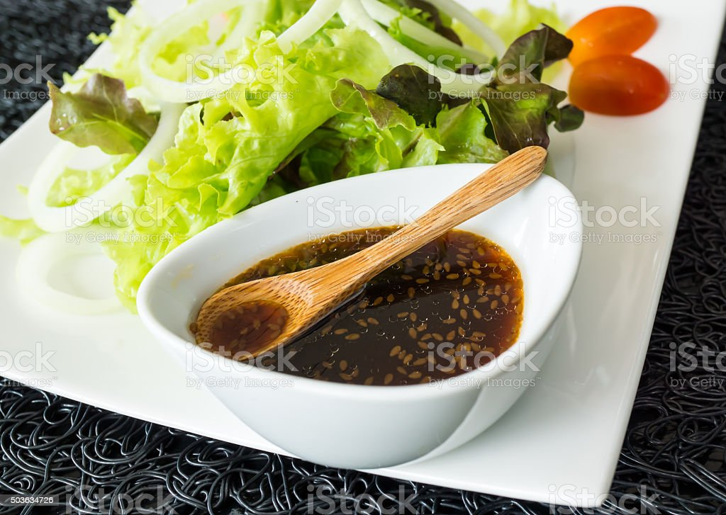 Salad and Japanese dressing stock photo