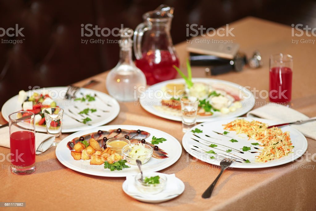 Salad and snacks in restaurant served for two persons royalty-free stock photo
