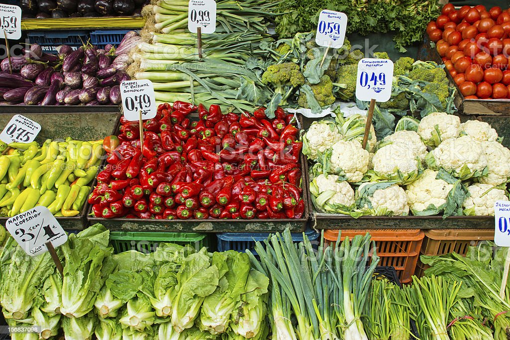 Salad and vegetables on a market royalty-free stock photo