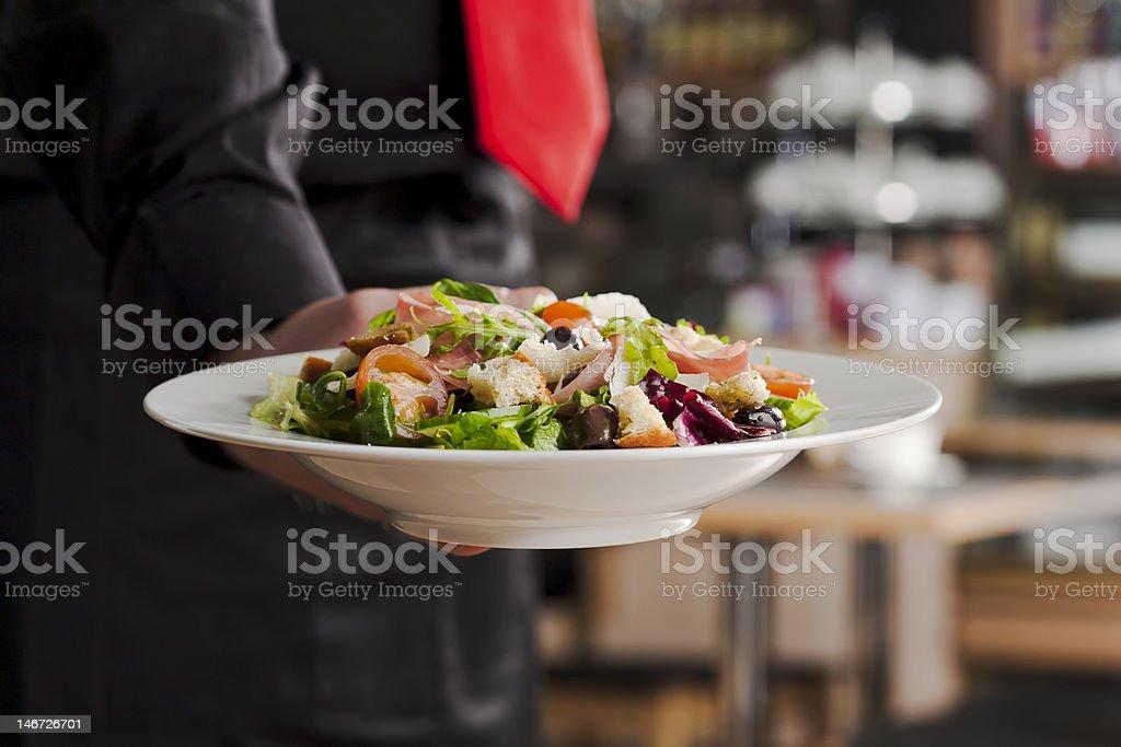 Salad and waiter royalty-free stock photo