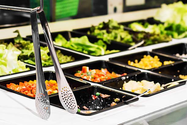 Salad  bar in a buffet line stock photo