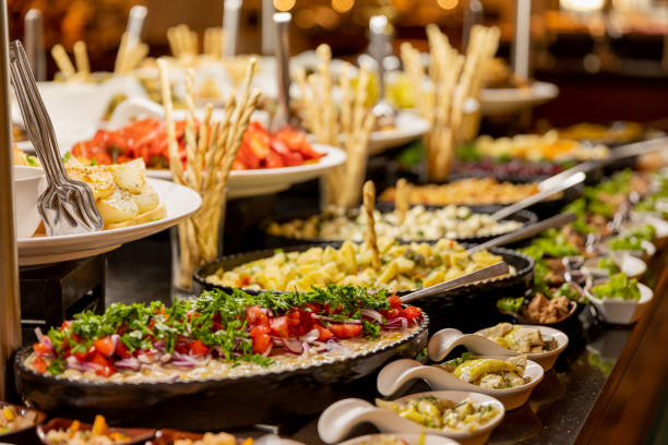 Salad bar. Salad trays on buffet ready to eat in restaurant stock photo