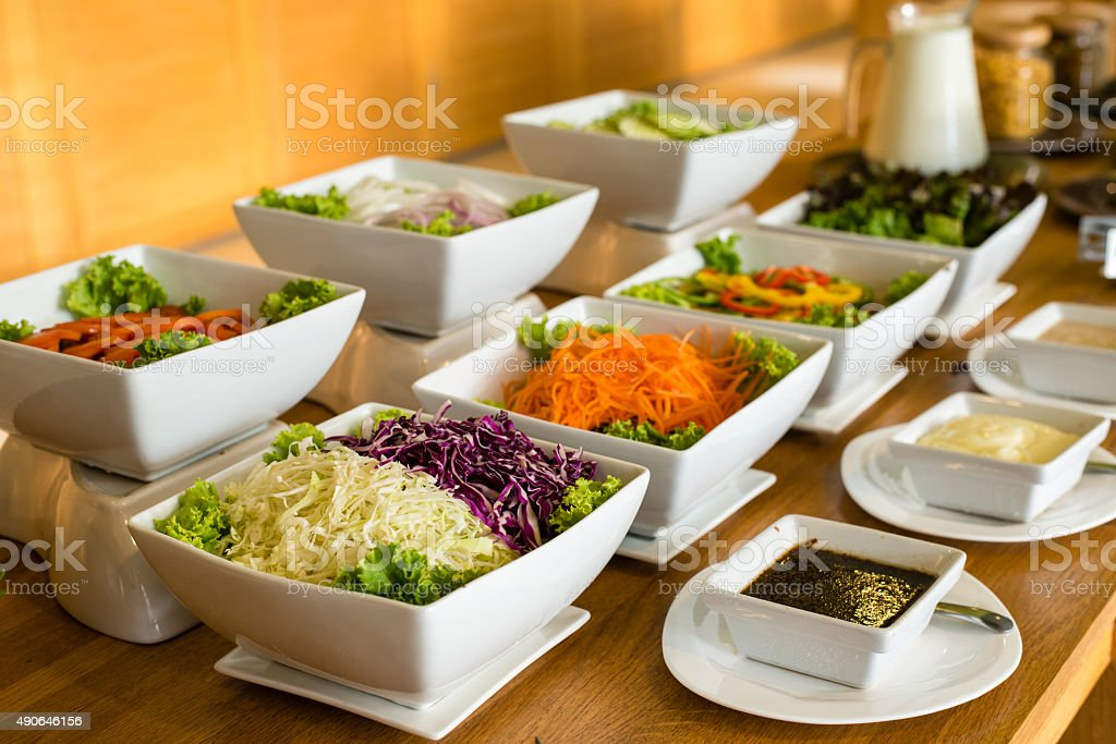 Salad bar with a variety of vegetables served buffet. stock photo