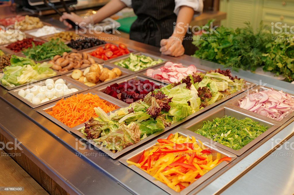 Salad bar with various fresh vegetables stock photo