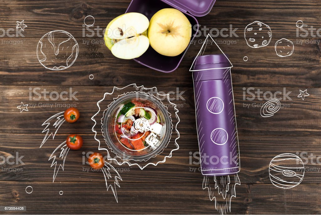 Salad bowl standing on the table near thermos royalty-free stock photo